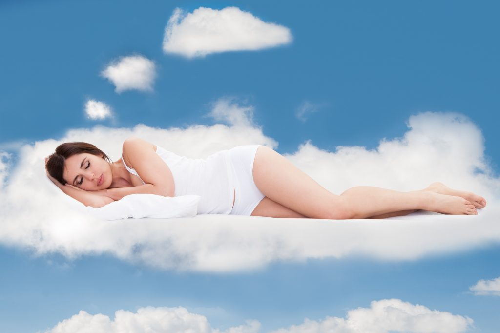 photodune 4234725 young woman sleeping on clouds l1